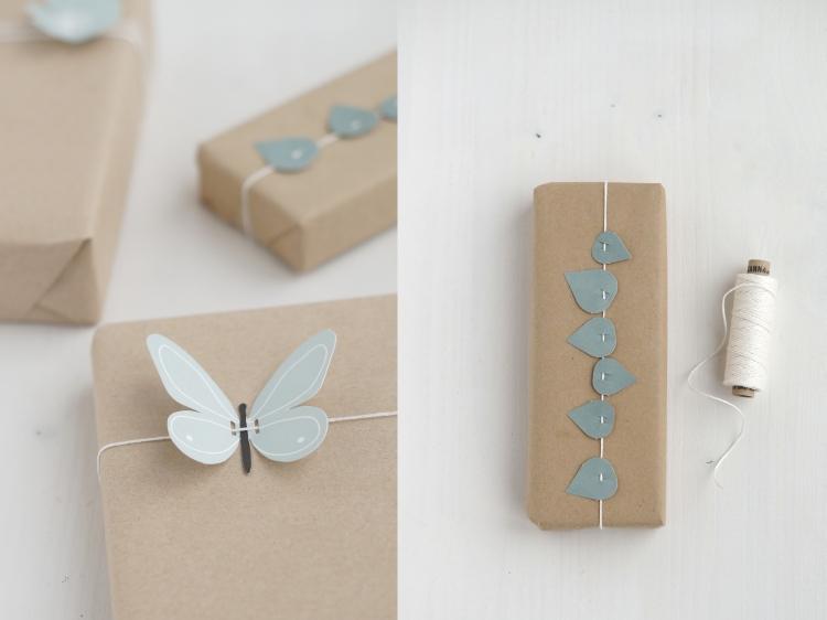 Kraftpapier, Papierschmetterling und Papierblättchen | Fotos: Sabine Wittig